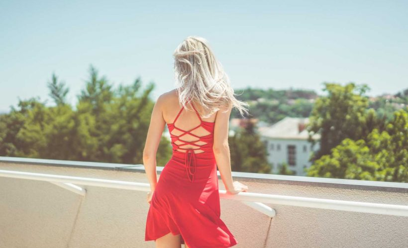 Young Blonde Woman Looking Around on Terrace