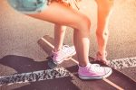 Young Girl with Pink Shoes on Longboard